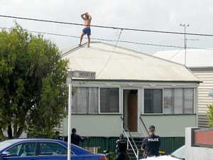 UPDATE: Police negotiations with roof-top man continue