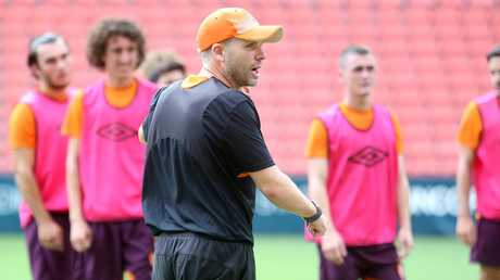 Interim Roar coach Darren Davies addresses his players at training.