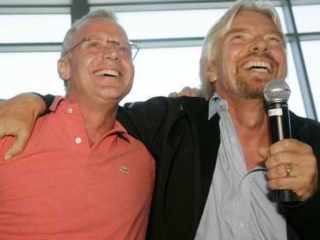 Former CEO of Virgin America, Fred Reid, with Virgin Group chairman Sir Richard Branson. Picture: AP/Jeff Chiu