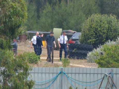 Detectives wander the Meningie property. Picture: Brenton Edwards