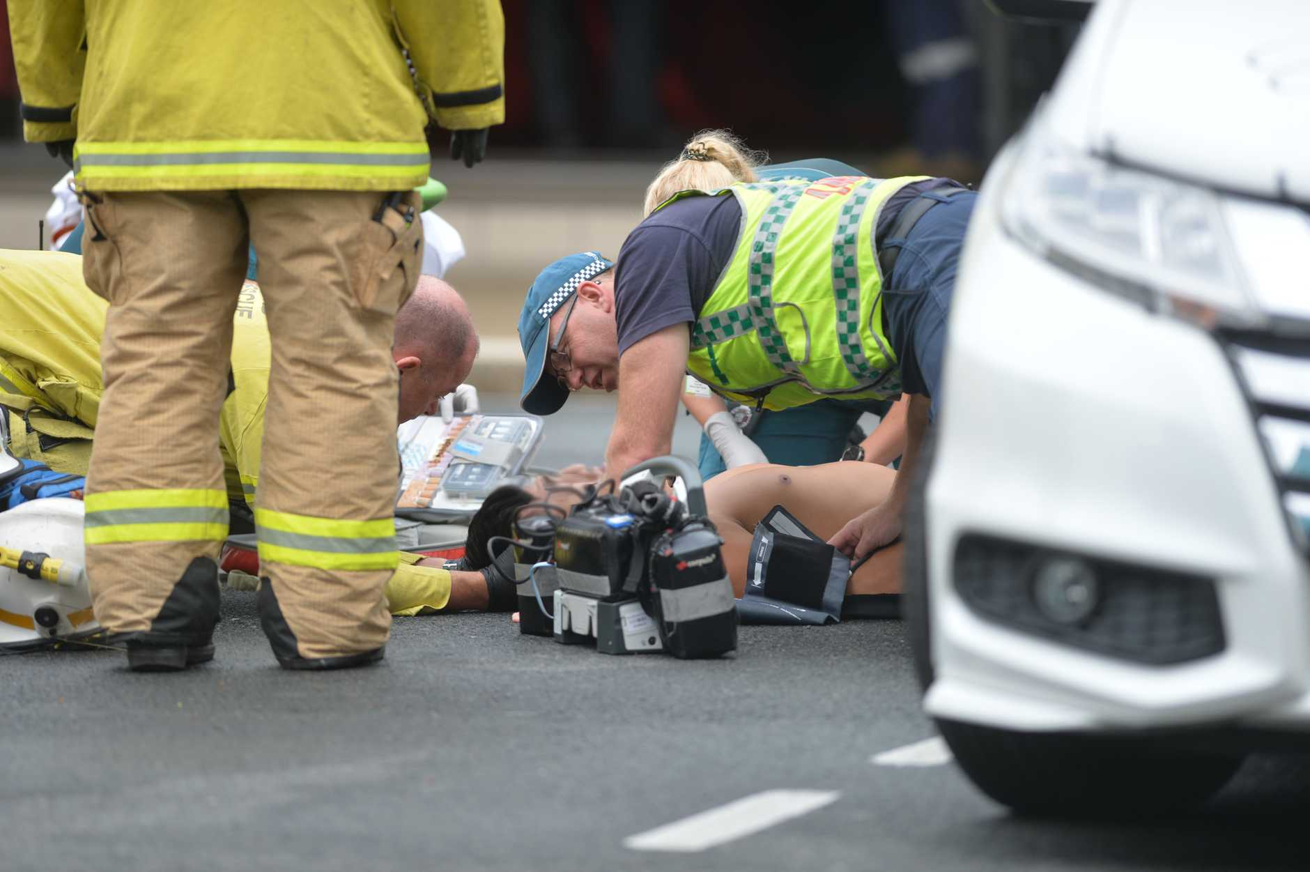 A man was treated by paramedics after a crash in the Mackay CBD