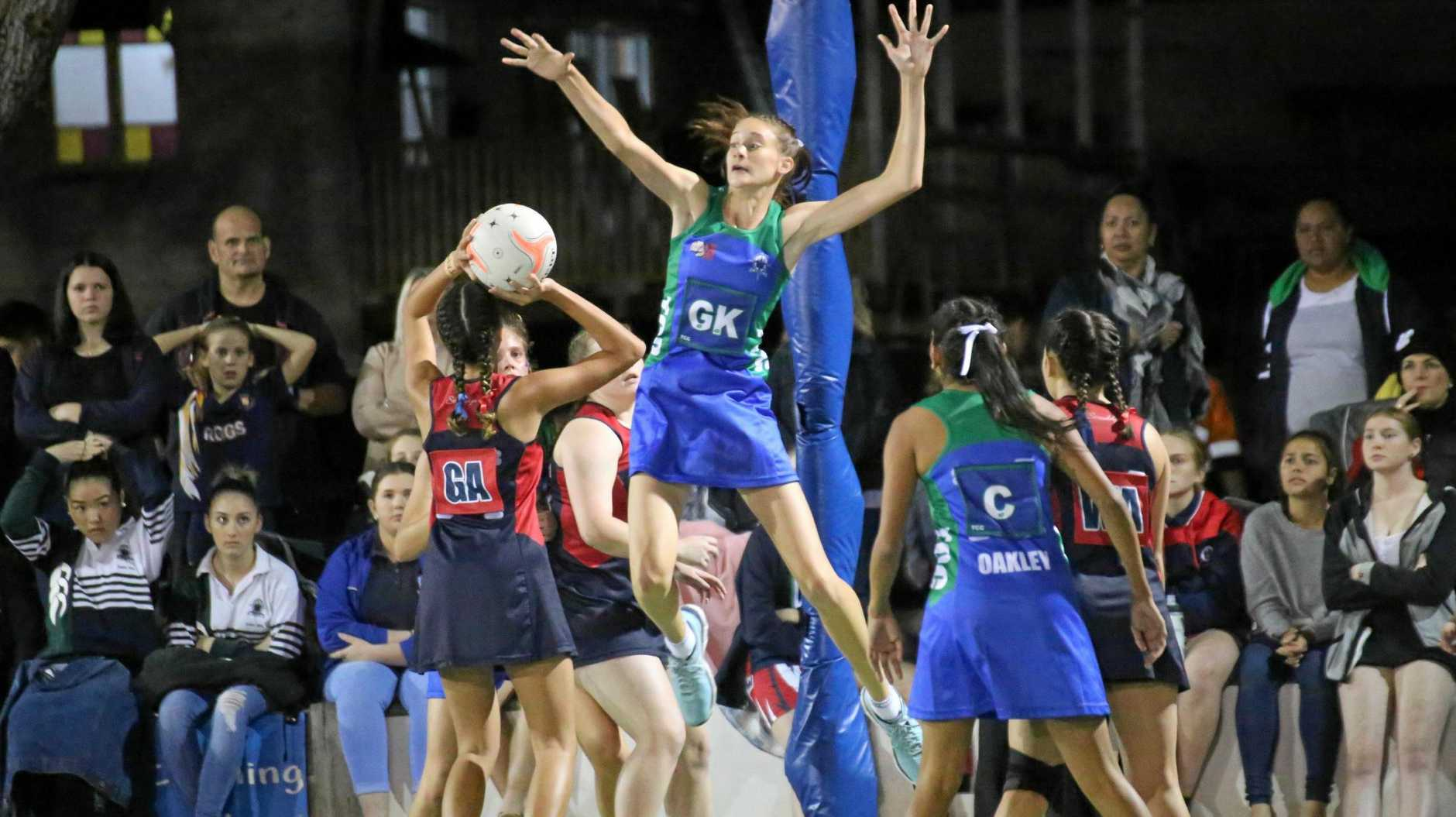 Isabelle Shearer launches into action for The Cathedral College netball team.