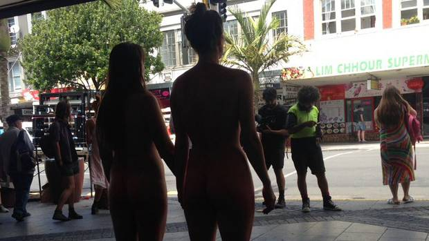 The two women attracted a crowd of spectators with their protest on K Rd yesterday. Photo / Twitter