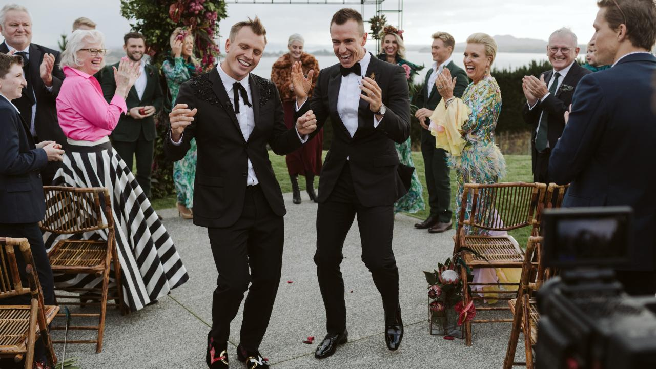 Peter Sunningham and Anthony Ikin dancing down the aisle after their wedding in New Zealand in May 2017. Credit: Bayly & Moore