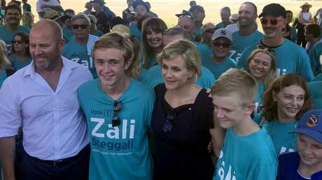 Zali Steggall poses for a photograph with her family during a press conference to announce her campaign. Picture: Luke Costin/AAP
