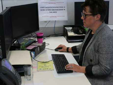 ACCCE Evaluation and Referral team leader Federal Agent Rebecca Goddard at her desk.