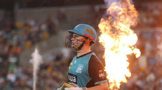 The Heat's Max Bryant heads out to bat on Friday night at the Gabba. Picture: Chris Hyde/Getty Images