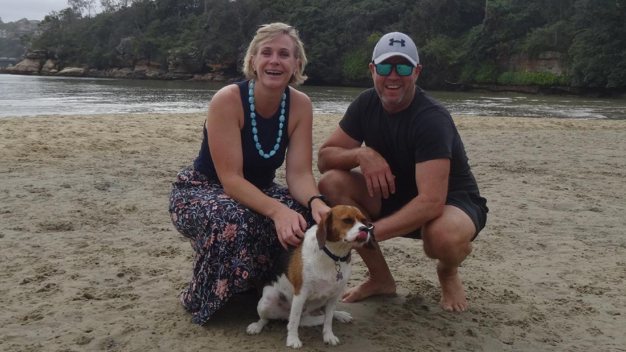 Zali Steggall and her husband Tim Irving take their dog Charlie for a swim at Clontarf.
