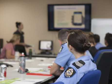 Police officers listen in on a ThinkUKnow presentation.