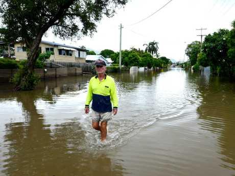 Townsville Floods: Hermit Park resident Ross Cribbin walks through part of Hodel Street still flooded. Picture: Evan Morgan