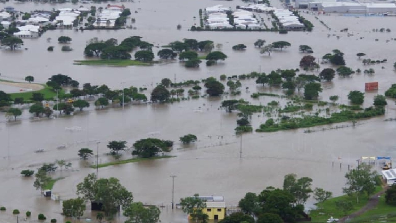 Hermit Park Tigers Football Club during the current floods in Townsville. Only the light poles surrounding the field and the yellow clubhouse can be seen. Picture taken from Facebook.