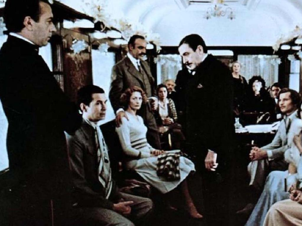 Albert Finney, centre, as Hercule Poirot in Murder On The Orient Express 1974. Picture: Supplied