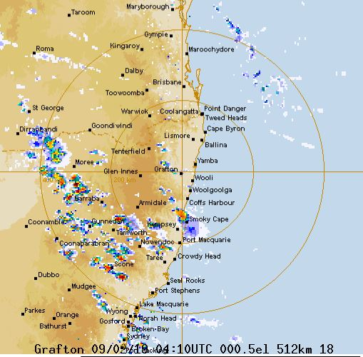 The Bureau's Grafton radar shows a large band of storm clouds tracking over the range towards the coast.