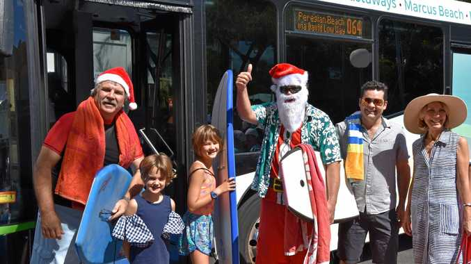 HOLIDAY GIFT: Santa Claus catching one of the Noosa Council's free holiday buses as one way to get around Christmas.