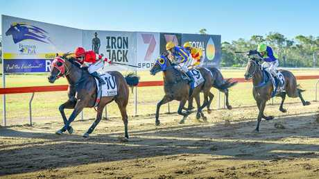TOP TWO: Denis Schultz-trained Lucifer's Angel wins race four in Saturday's twilight races ahead of second place New Kintaro trained by Lee Kiernan.