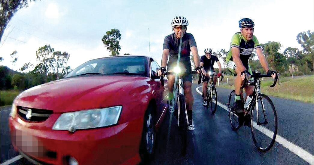 NEAR MISS: A Red Holden overtook three cyclists Saturday morning in Rockhampton, almost knocking the cyclist on the right of his bike.