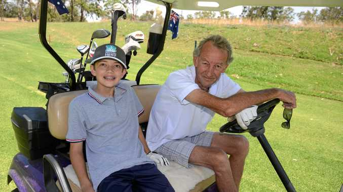 Xavier Byrne and his grandfather Bill Morrison during a Sunday morning round at the Warwick Golf Club,