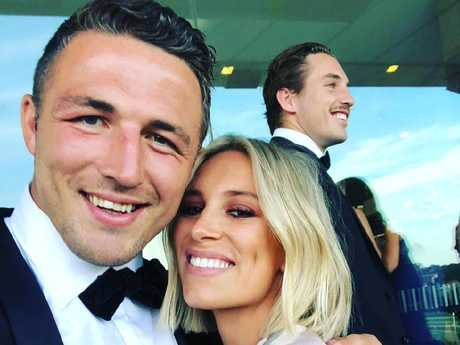 Sam Burgess and Phoebe at the wedding of Damien Cook in November.