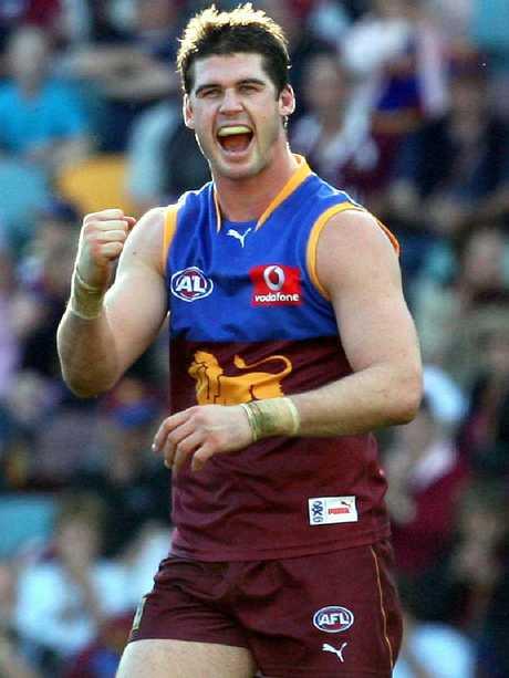 Jonathan Brown celebrates a goal.