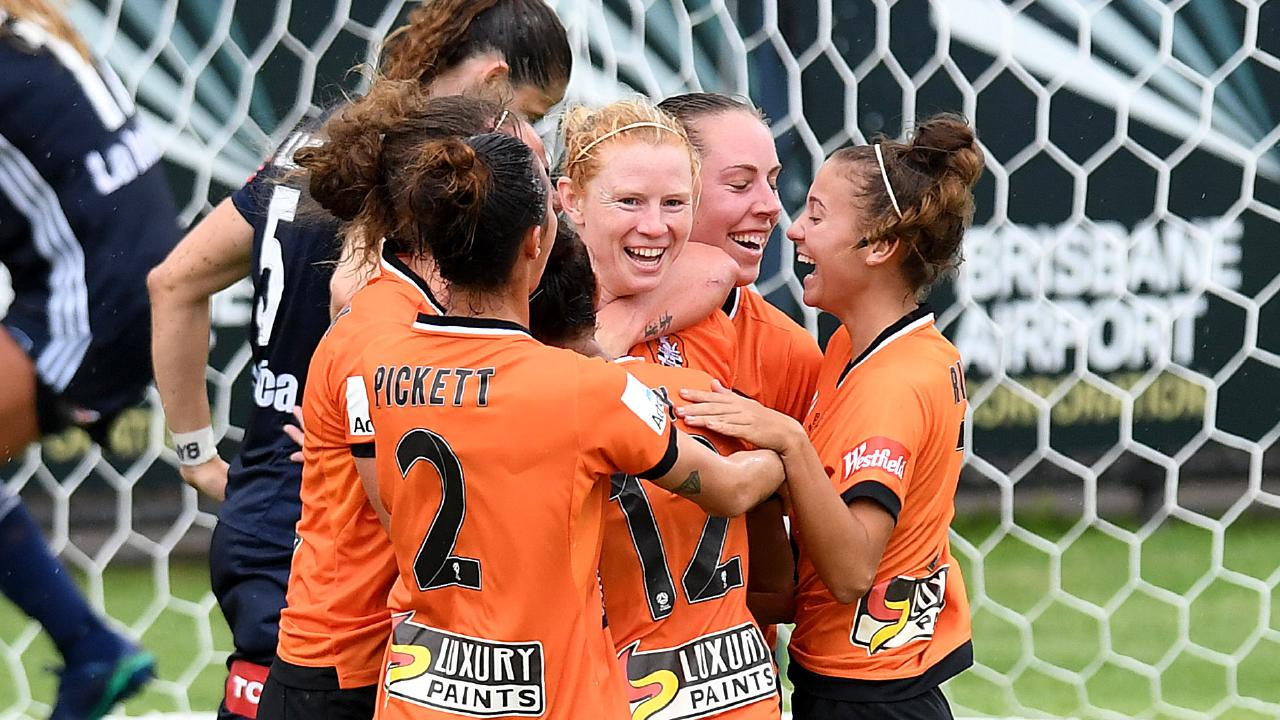 Clare Polkinghorne celebrates with teammates after scoring a goal last year.