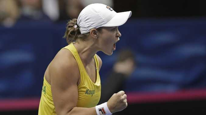 Australia's Ashleigh Barty reacts after defeating United State's Sofia Kenin in their first-round Fed Cup tennis match in Asheville, N.C., Saturday, Feb. 9, 2019. (AP Photo/Chuck Burton)