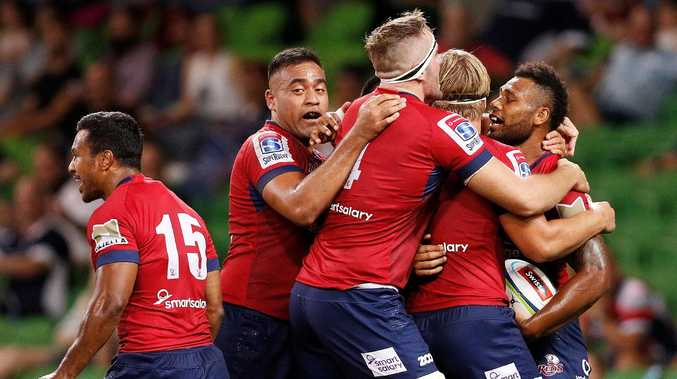 Samu Kerevi (R) of the Reds celebrates a try with teammates during the round two Super Rugby match between the Melbourne Rebels and the Queensland Reds at AAMI Park on February 23, 2018 in Melbourne, Australia. (Photo by Daniel Pockett/Getty Images)