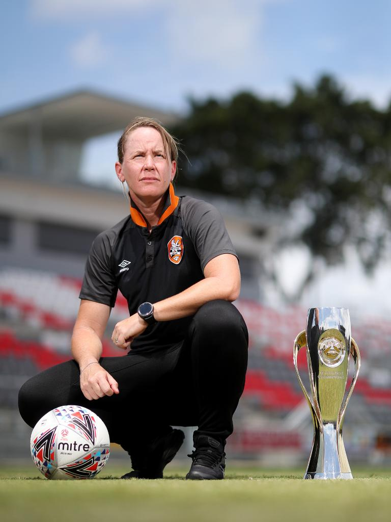 Roar W-League coach Mel Andreatta at Redcliffe's Dolphin Stadium with the W-League Championship Trophy.