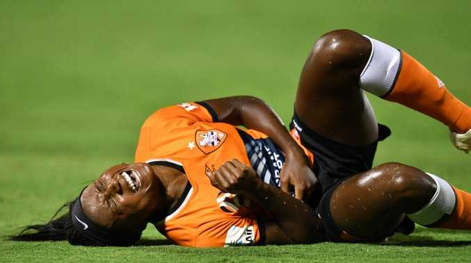 Chioma Ubogagu clutches her ribs after a tackle. Picture: Getty