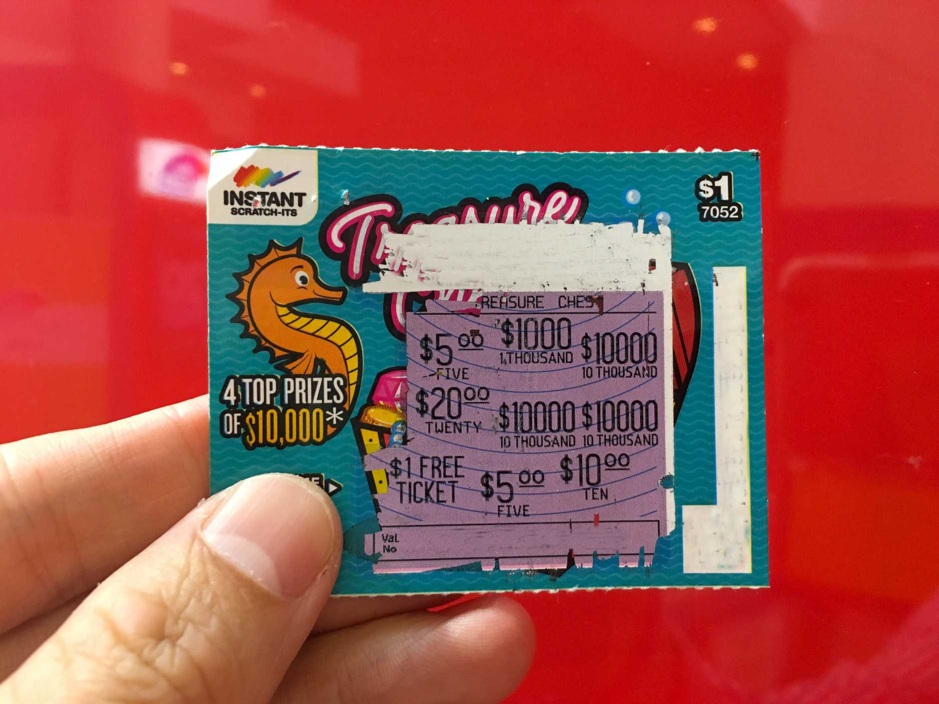 An Oakey mum is $10,000 richer after winning on this Instant Scratch-It.