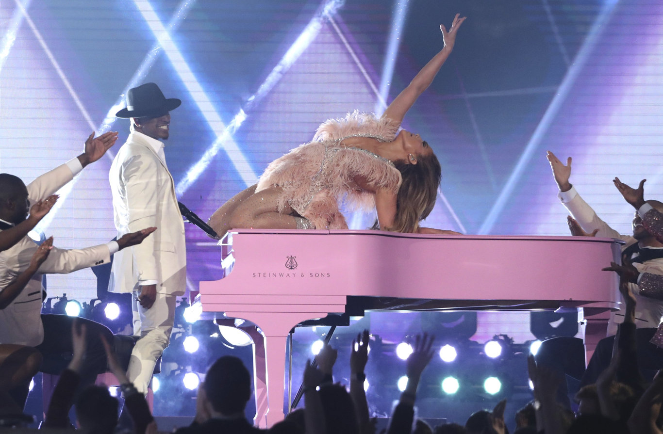 Ne-Yo, left, and Jennifer Lopez perform a medley during a tribute to Motown's 60th anniversary at the 61st annual Grammy Awards in Los Angeles. (Photo by Matt Sayles/Invision/AP)