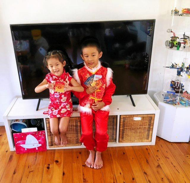 HAPPY NEW YEAR: Harrison and Layla Li after receiving traditional red envelopes with money from grandparents on Lunar New Year.