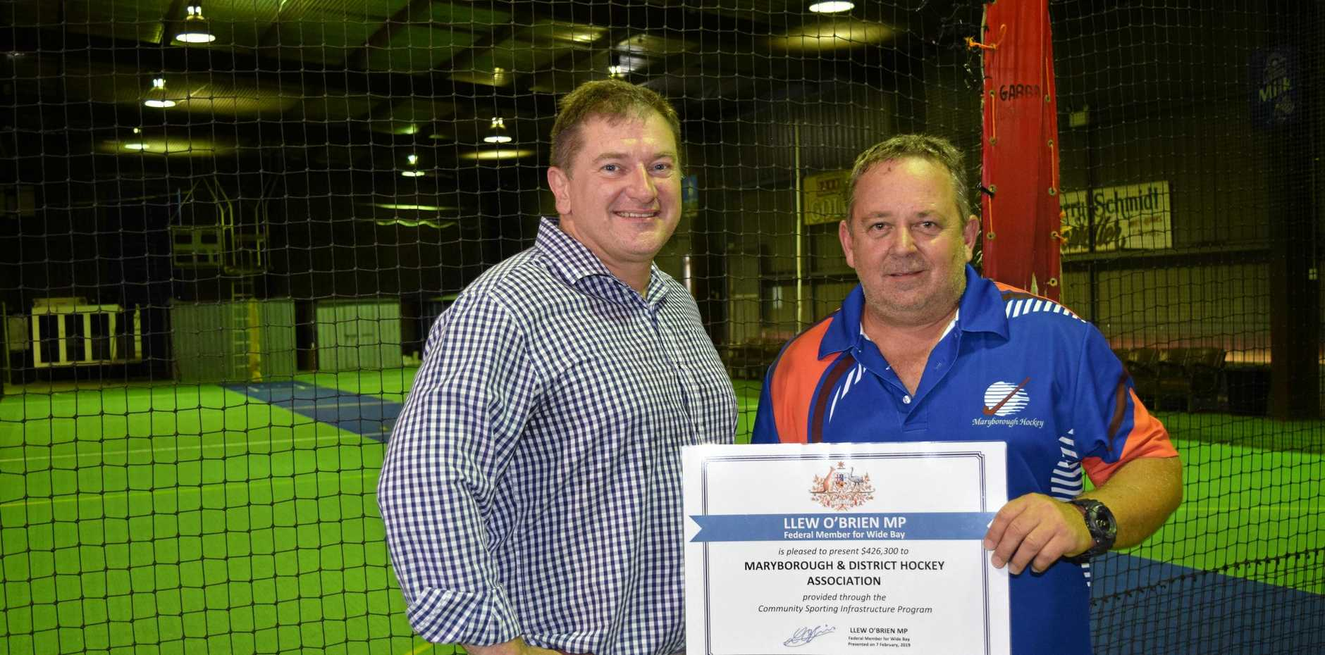 NEW FUTURE FOR HOCKEY: Wide Bay MP Llew O'Brien and Maryborough and District Hockey Association president Tony Quaill with the grant for the new indoor hockey centre, funded through the Federal Government.