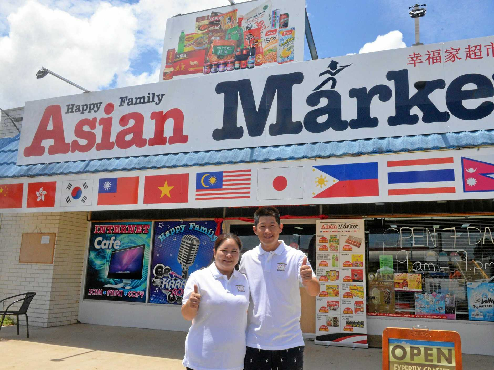 OPEN FOR BUSINESS: Happy Family Asian Market owners Chantelle Wong and Max Lu outside their store.