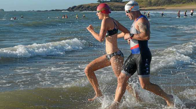 MAKING A SPLASH: Sally Adamski and Clint James hit the water at Emu Park in the Fitzroy Frogs' first race event of the year on Sunday morning.