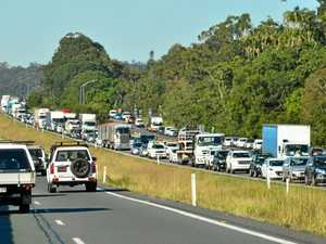 Man hospitalised, traffic blocked after Bruce Hwy crash