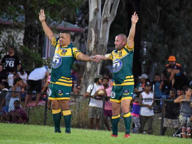 OVER HERE: Chris Walker and John Hopoate do their best impression of a goal post.