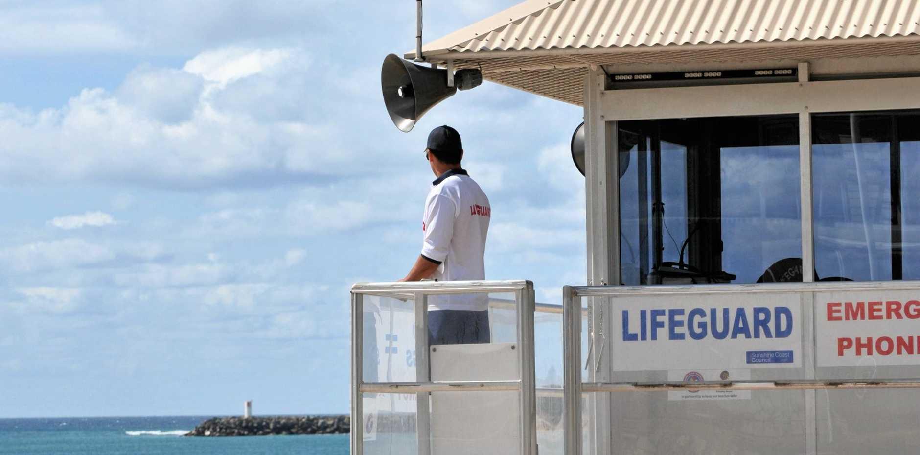 A Sunshine Coast Council Lifeguard keeps a watch over Mooloolaba Beach. Photo: Brett Wortman / Sunshine Coast Daily