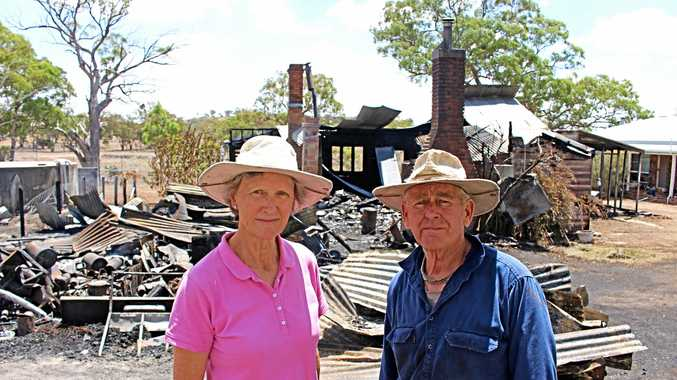 RUINS: Margaret and Clive Smith have been left to sift through the ruins of three structures after a fire on Saturday tore through the buildings on their property.
