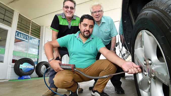 EXCEPTIONAL SERVICE: Casey's Tyre Service new owner Rubal Sharma, (front) with retiring owner Len Casey (back right) and his son Cameron (back left). The store's driveway service will remain under new ownership.
