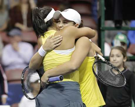 Barty hugs doubles partner Hon after their win.