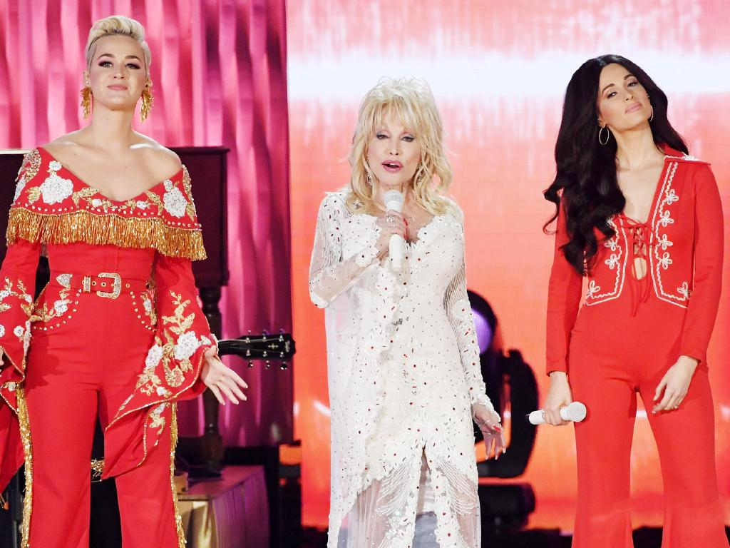 Katy Perry, Dolly Parton, and Kacey Musgraves perform onstage during a tribute to Parton at the Grammys.