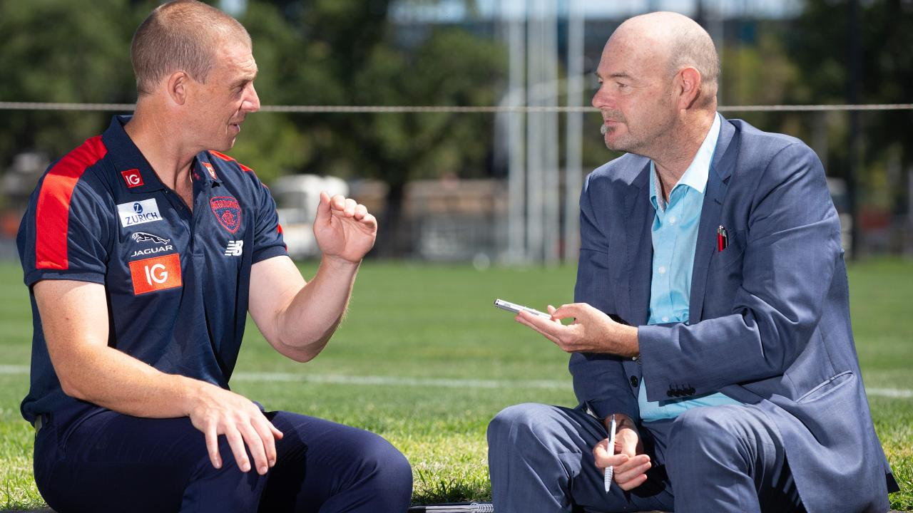 Simon Goodwin speaks to Mark Robinson at Gosch's Paddock. Picture: Sarah Matray