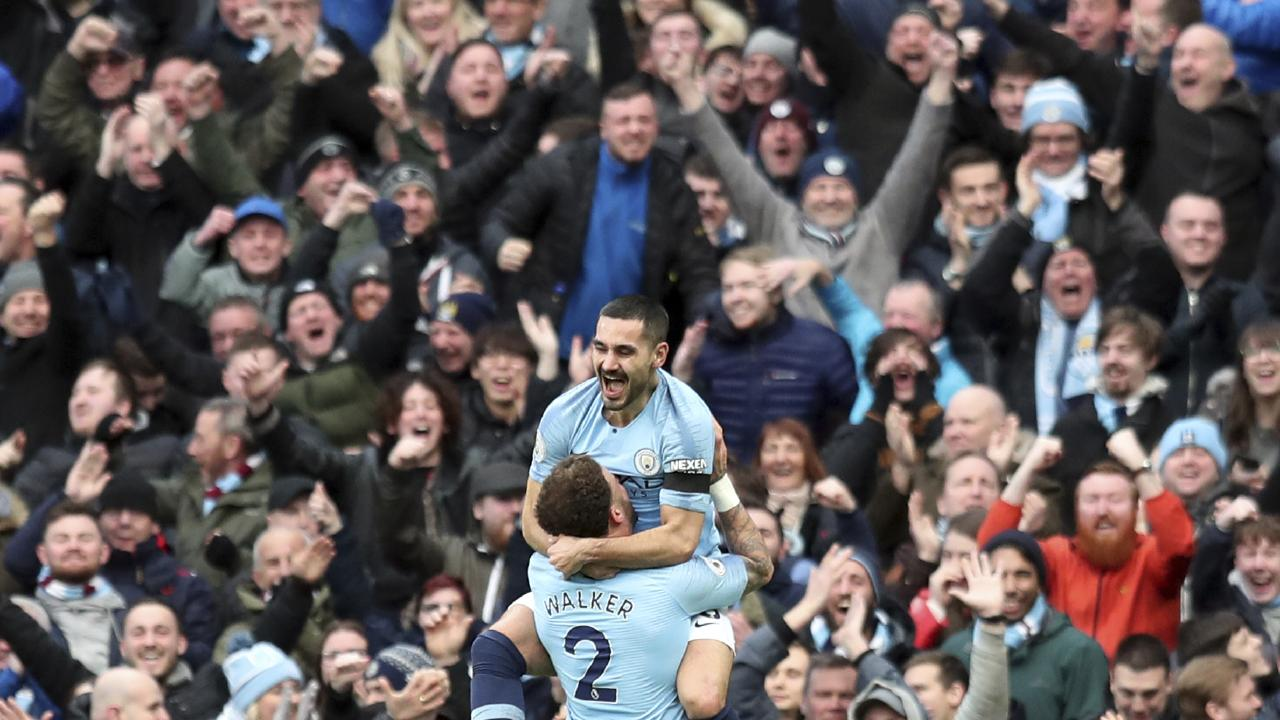 Manchester City's Ilkay Gundogan, top, celebrates with Kyle Walker after scoring his side's fourth goal (AP Photo/Jon Super)
