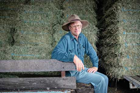 RUNNING OUT: Gatton hay farmer John Lester with some of his lucerne.