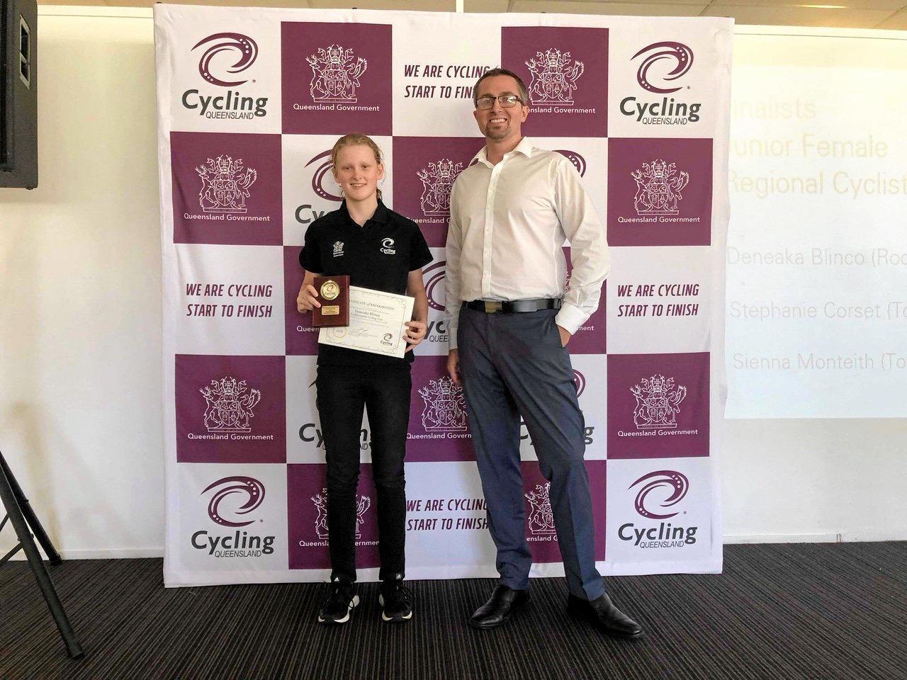 Rockhampton's Deneaka Blinco receives the Junior Regional Cyclist of the Year award from Cycling Queensland's CEO Sean Muir.