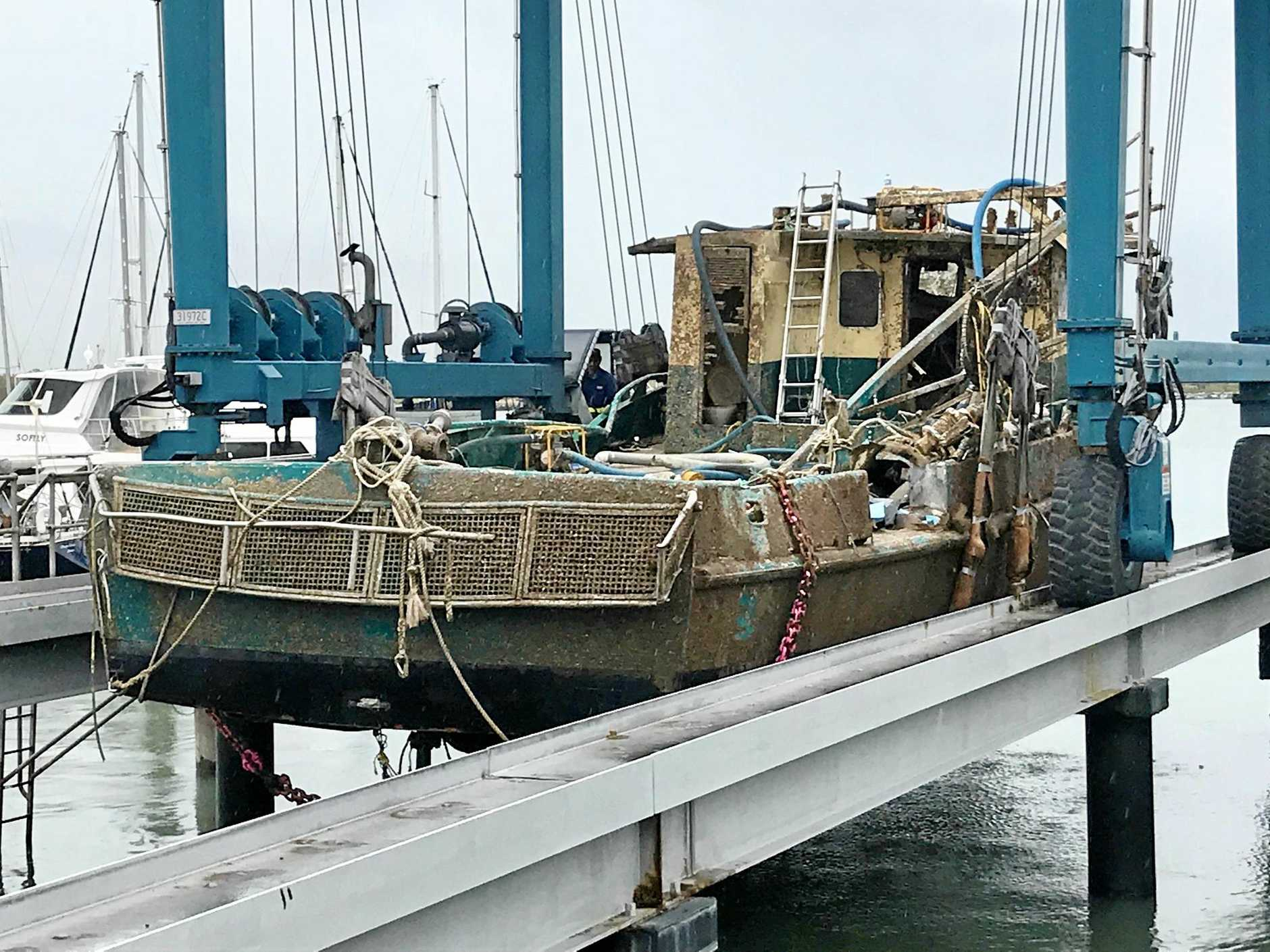 The Dianne being lifted out of the water after its recovery.