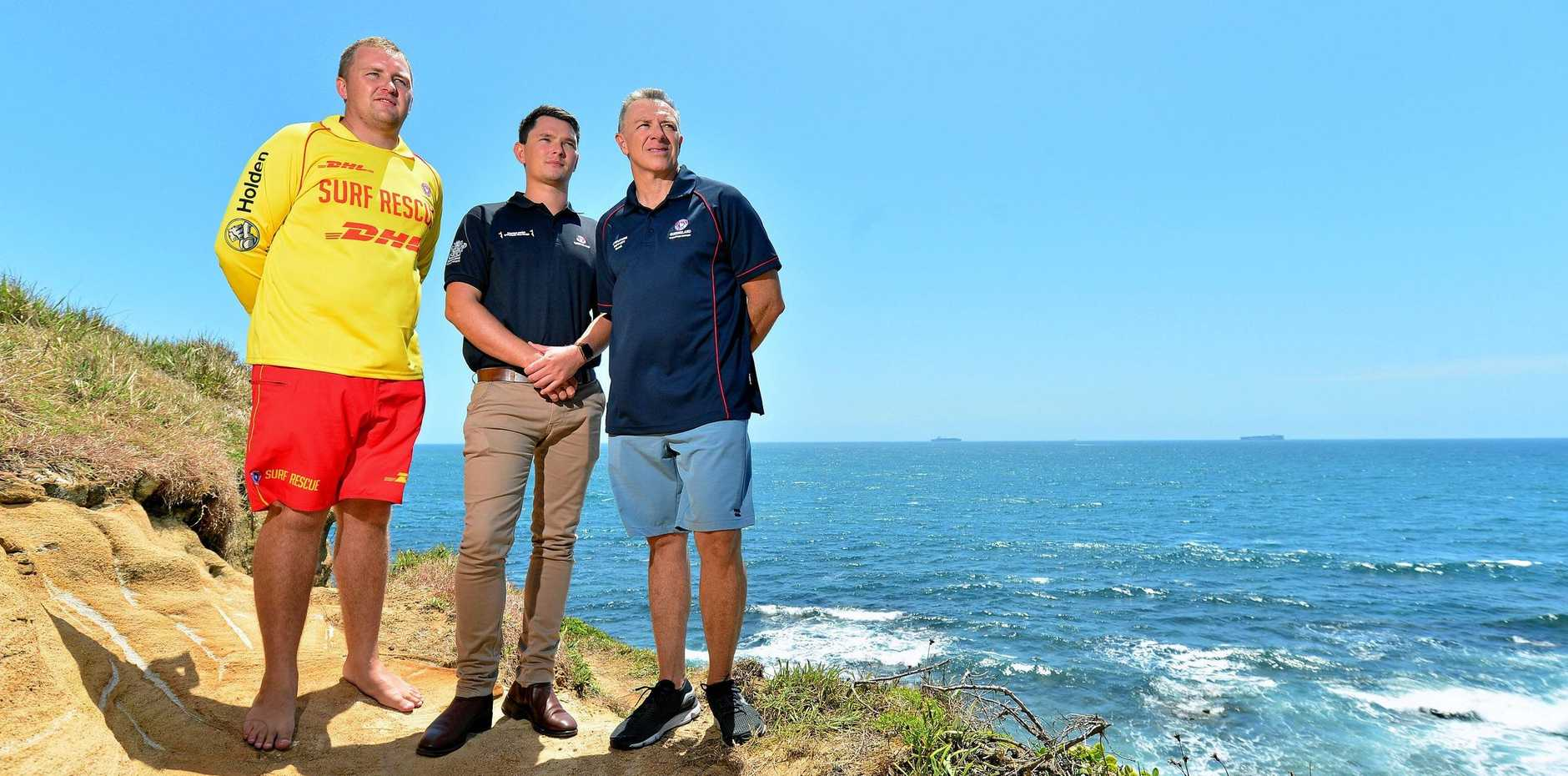 ACTION MEN: (L-R) Nathan Steer, Jacob Thomson and Graham Sharry were the first lifesavers to respond to reports Kyle Roberts' kayak had been attacked by a large tiger shark. Dave McLean joined the team, working as comms coordinator for the rescue.