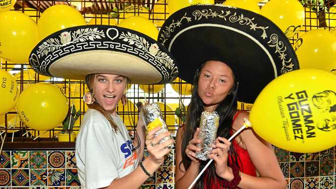 MEXI-YUM: Guzman Y Gomez opened yesterday at Birtinya and thousands, including Darcy Page and Talishe Clarke, turned up for free burritos.