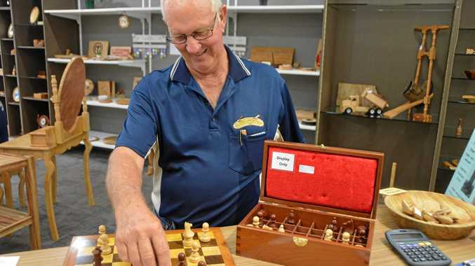 PROUD AS PUNCH: Dick Rasmussen with his chess set at the South Burnett Woodcrafters pop-up shop at Kingaroy Shoppingworld.