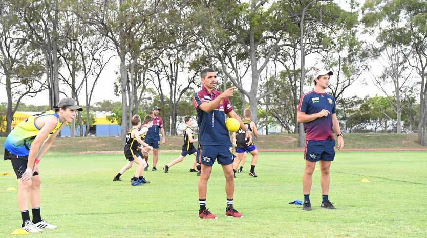 ON TRACK: Brisbane Lion Charlie Cameron instructs a group with fellow Lion Corey Lyons at Shalom College.